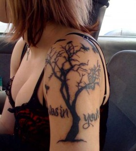 Dead tree arm tattoo