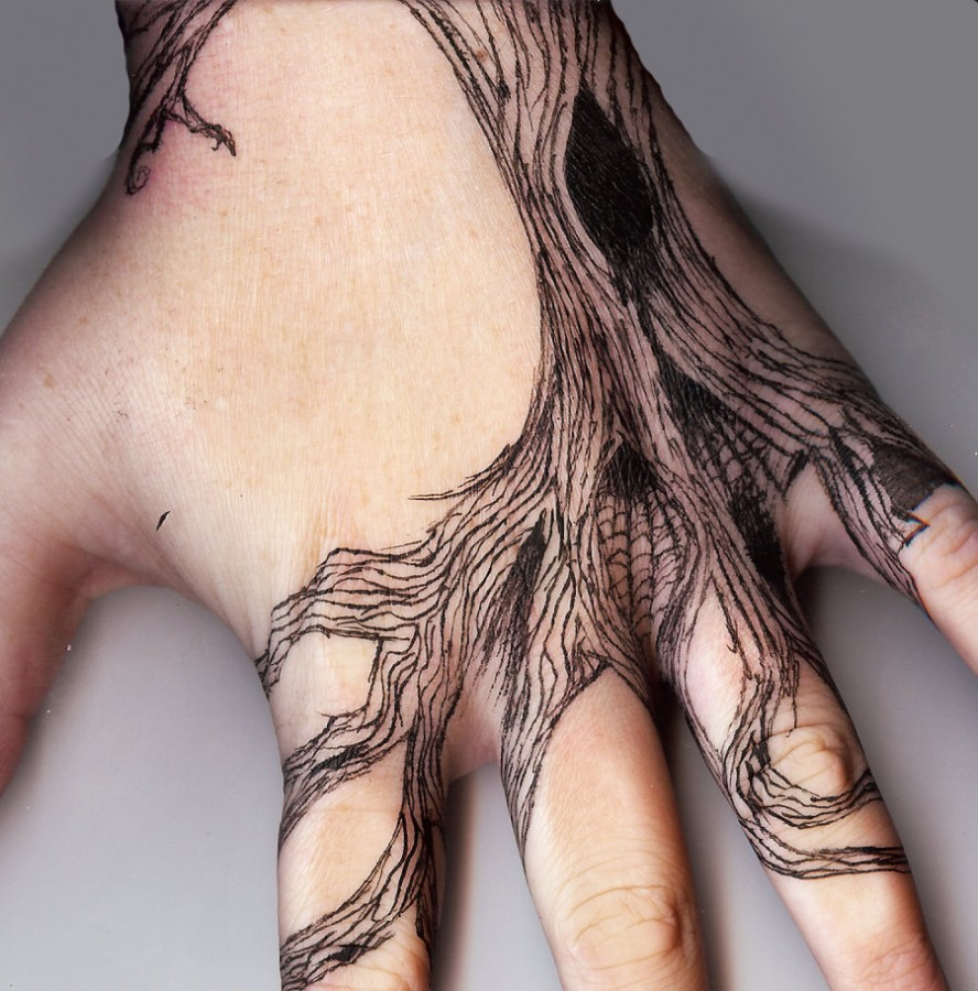 Dead tree hand tattoo