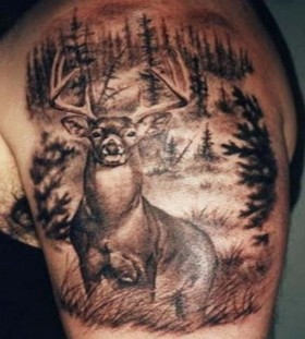 Deer and forest arm tattoo