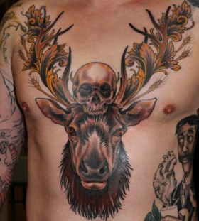Deer's head and skull tattoo
