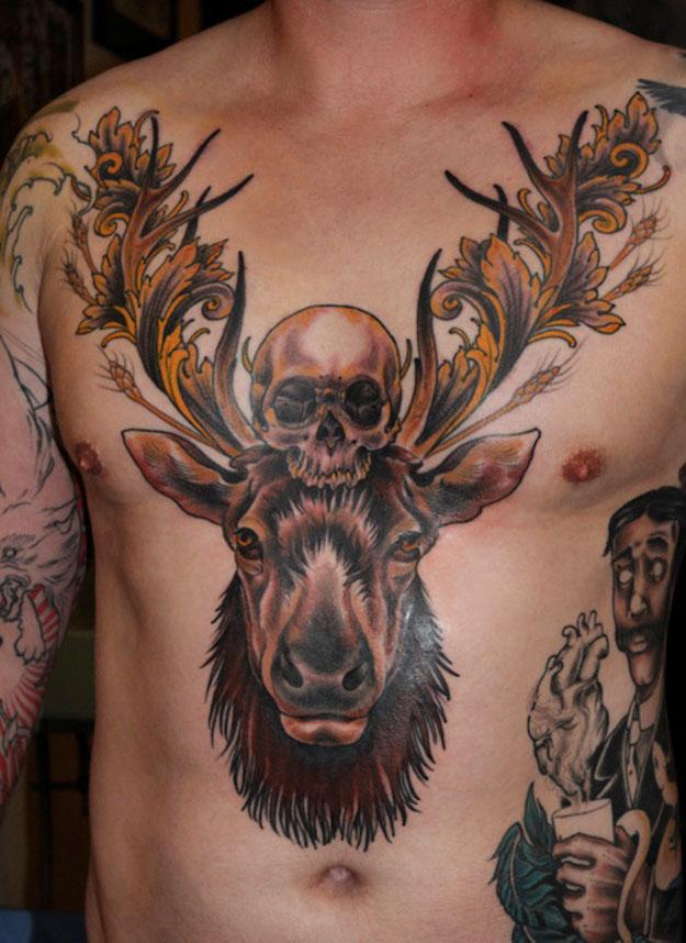 Deer's head and skull tattoo