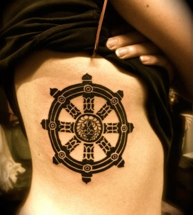 Dharma wheel side tattoo