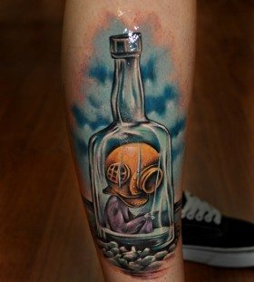 Diver in a bottle tattoo by Benjamin Laukis