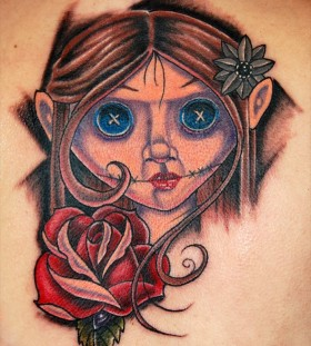 Doll face and rose tattoo