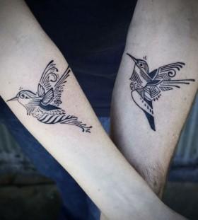 Double black tribal bird tattoo