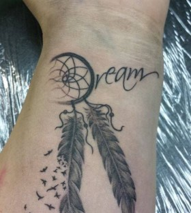 Dream catcher black wrist tattoo