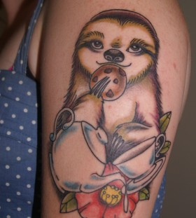 Eating sloth arm tattoo