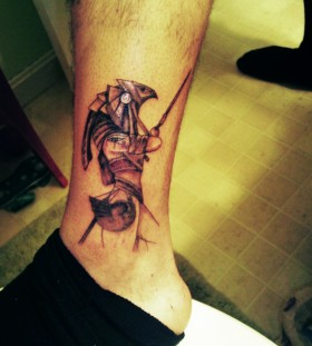 Egyptian god horus ankle tattoo