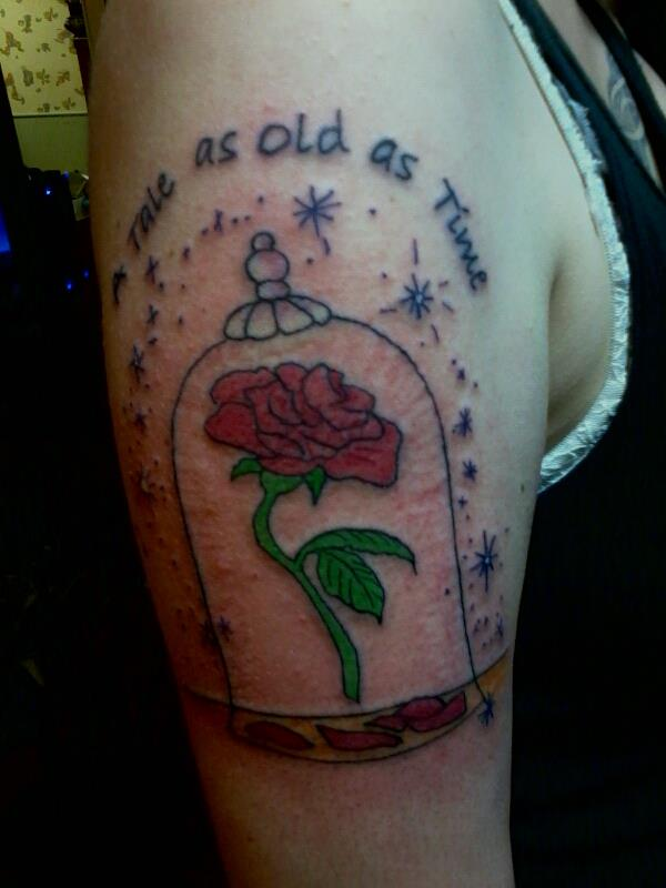 Enchanted rose and quote tattoo