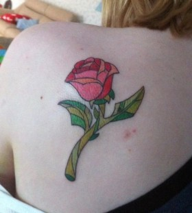 Enchanted rose back tattoo
