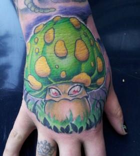 Evil mushroom hand tattoo