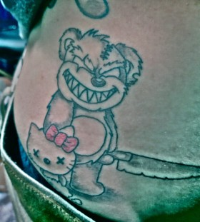 Evil teddy bear tattoo