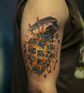 Exploding grenade arm tattoo