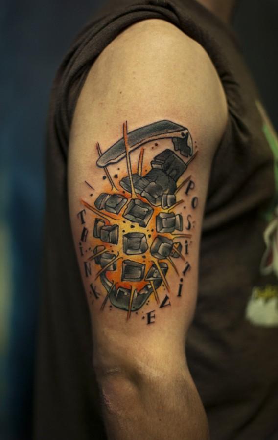 Exploding grenade arm tattoo