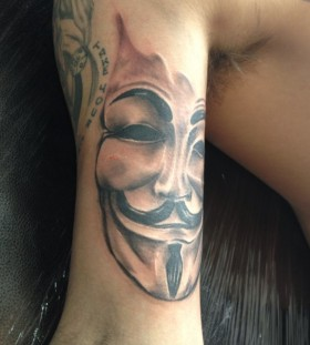 Face of V arm tattoo