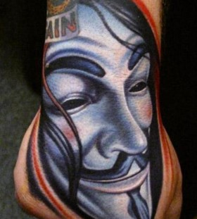 Face of V hand tattoo