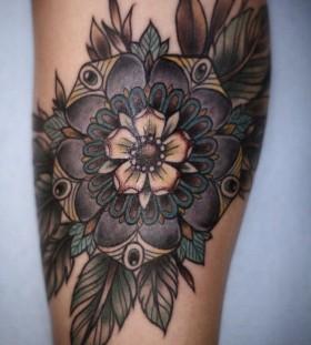 Feather and colorful mandala tattoo