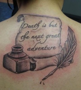 Feather pen and quote tattoo