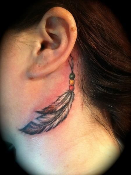 Feather tattoo on neck by Jessica Brennan