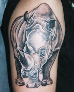 Fierce rhino arm tattoo