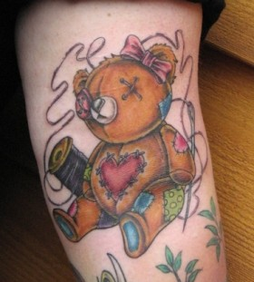 Fixed teddy bear tattoo
