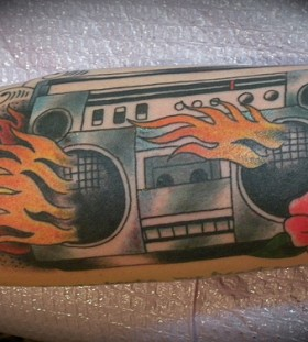 Flaming boombox and flower tattoo