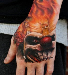 Flaming clown tattoo by Kyle Cotterman