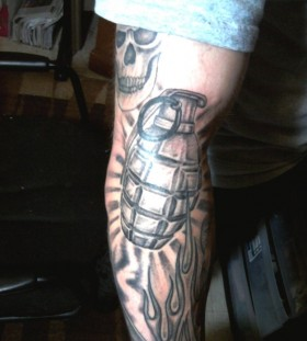 Flaming grenade arm tattoo