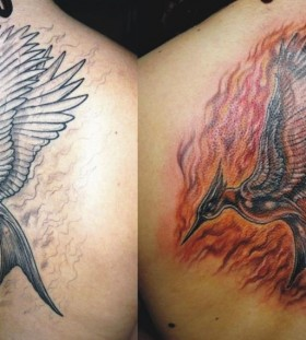 Flaming mockingjay back tattoo