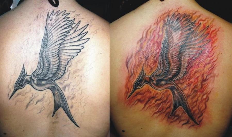Flaming mockingjay back tattoo