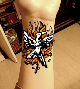 Flaming mockingjay wrist tattoo