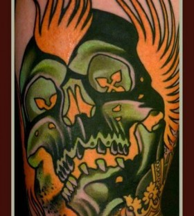 Flaming skull tattoo by Lars Uwe Jensen