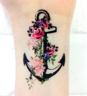 Flowers and anchor wrist tattoo