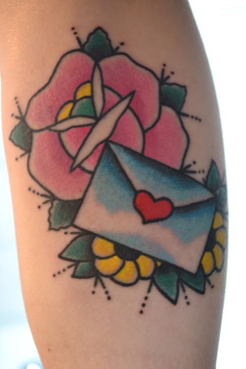 Flowers and envelope tattoo