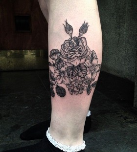 Flowers tattoo on leg by Rebecca Vincent