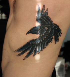 Flying raven side tattoo