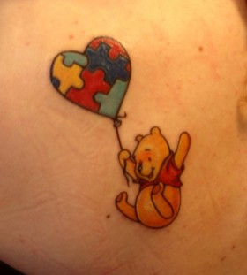 Flying winnie with a balloon tattoo