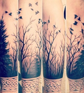 Forest, trees and tribal bird tattoo