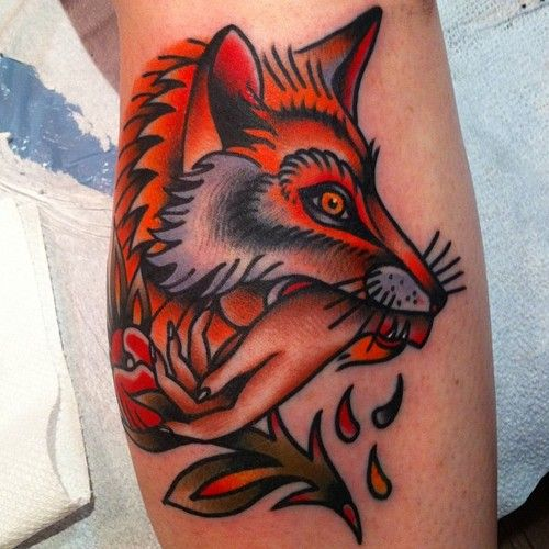 Fox bitting hand tattoo by Nick Oaks