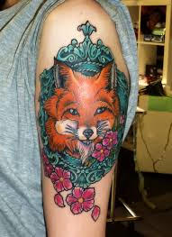 Fox frame arm tattoo
