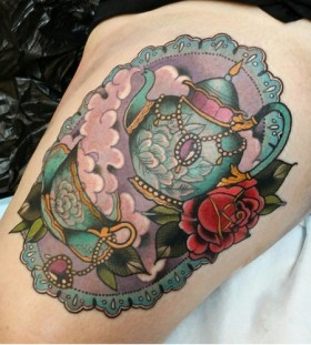 Framed teapot and rose tattoo