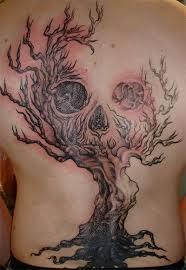 Frightening dead tree tattoo