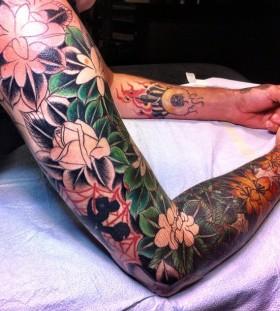 Full arm jungle tattoo