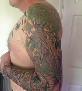Full arm tree tattoo