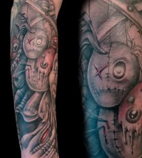 Full arm voodoo dolls tattoo