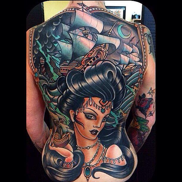 Full back tattoo by W. T. Norbert