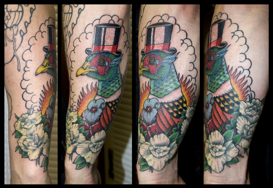 Funny pheasant with a hat tattoo
