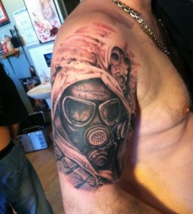 Gas mask arm tattoo