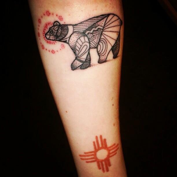 Geometric bear arm tattoo