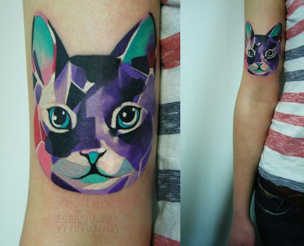 Geometric cat arm tattoo